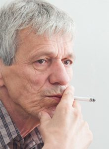 Smoking is not the only cause of lung cancer - elderly man smoking